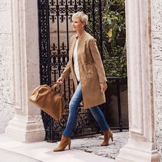 Looking for the perfect camel coat? Who isn't. This duster length is updated with gold-tone hardware a drawstring waist for the most flattering of details.