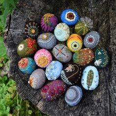 stitched stones by Lisa Jordan of lil fish studios - real stones cocooned in wool and stitched. Meditations on nature.