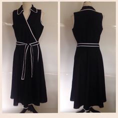1980s vintage linen wraparound dress Black linen with white linen trim Belted with matching linen tie belt Very full skirt  Label: JM