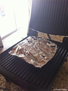 Foil grilled salmon on a george foreman (or panini maker)
