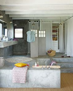 concrete bathroom, built-in bathtub. Not likely to happen but very unique
