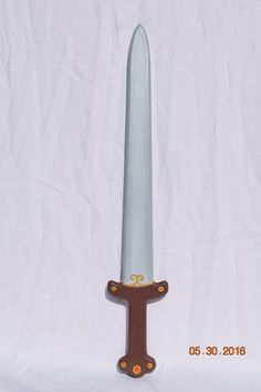 Here is a Viking sword that belongs in the hands of a true warrior. Modeled after the great ancient swords whose technique and creator is still unknown, but whose quality is renowned. Whether your little one wants to take to the seas and find the treasures of unknown lands or battle such mythical beasts as the mighty wolf Fenrir, here is a trusty sword to take along in any of your child's imaginings.  Made out of one piece of solid pine, this sword was cut, shaped, sanded and painted to…