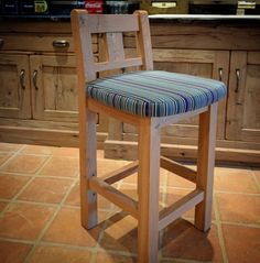 Chunky Upholstered Oak Kitchen Stool with back support.