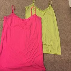 Set of two tank tops Attention brand set of two tank tops. Pink /yellow green. 93% nylon 7% spandex. Size large-xlarge Attention Tops Tank Tops