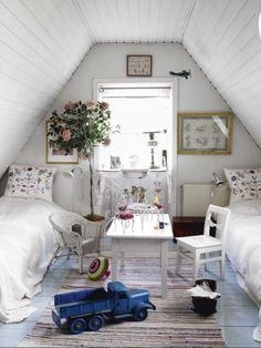 similar layout to haley and cameron's sleeping space... love the added greenery and wall art above beds.  love the rug between the beds and the cluttered lived in look