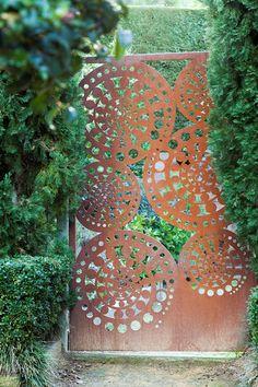 Laser cut 'Kuru' gate. Rusty metal steel by Entanglements