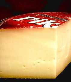 Gouda cheese (kaas) is Dutch - But you might want to learn how to properly say it while living in the Netherlands - Hear how to say it here:  http://upload.wikimedia.org/wikipedia/commons/9/9a/Nl-Gouda.ogg