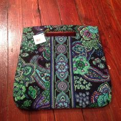 Retired Vera Bradley 2009 holiday tote in blue rhapsody. Never used. Type with detachable shoulder strap. Magnetic closure. Tags still on. Smoke free home. No signs of wear. Vera Bradley Bags Totes