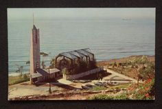 """photo of the Wayfarers Chapel in Palos Verdes California. The Wayfarer Chapel also known as """"The Glass Church"""" was designed by Lloyd Wright (son of Frank Lloyd Wright) in the late and was built between 1949 and Wayfarers Chapel, San Luis Obispo County, Wedding Venues Texas, Wedding Locations, Lloyd Wright, Old Postcards, Minimalist Home, Aerial View, Architecture Design"""