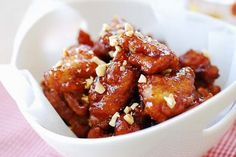Dakgangjeong is a crispy Korean fried chicken glazed in a sticky, sweet, tangy and spicy sauce. So addictive! Easy to make at home!