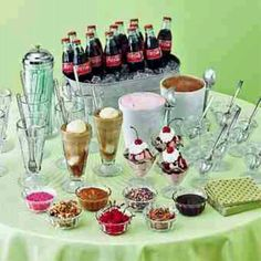 Root beer float bar and sundae bar. Would use pre made scoops of ice cream in mason jars on ice. cokes and root beer  bottles on table :o)