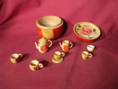Does anyone else remember these little tea sets in wooden apples? Tonight's Book Art lecture at the Milwaukee Art Museum with JoAnna Poehlmann and Barbara Brown Lee featured one of the apples and got me thinking.