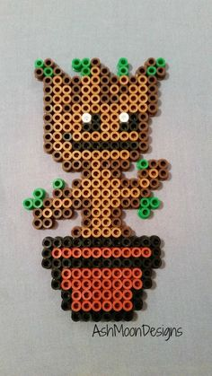 I am (dancing baby) Groot! My absolute favorite part of the Guardians of the Galaxy movie was the last scene with dancing baby Groot, so I just had to make a perler bead figure of him to put on dis. Perler Bead Designs, Pearler Bead Patterns, Perler Patterns, Perler Beads, Perler Bead Art, Fuse Beads, Filet Crochet, Crochet Pixel, Pixel Art