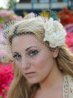 Bandeau Birdcage Veil and detachable flower Fascinator with peacock eyes Vintage inspired Blusher hair flower in ivory or white. $65.00, via Etsy.