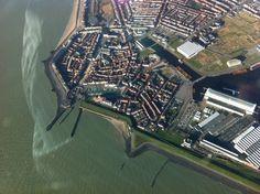 Luchtfoto van de binnenstad, strand, jachthaven en ons kantoor, 10/01/2014.
