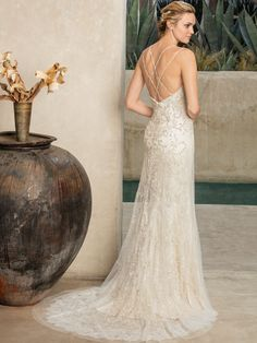 Style 2295 Jade is the perfect gown for a sparkling socialite, as she showcases the quintessential exquisite beadwork Casablanca Bridal is known for, atop ...