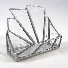 Elegant and abstract, this hand crafted stained glass business card holder will draw attention to your business cards in a subtle way. An interesting