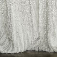 Mistral - Spray is a 100% linen fabric, woven and washed to show the rippled effect on the sand dunes and sea created by the wind.
