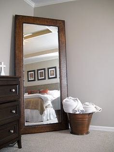 Mirror for master bedroom.... Maybe do this with the giant mirror I've been dreading hanging up