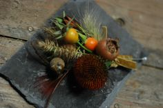 Buttonhole with Medlar and petal less echinacea. - autumn