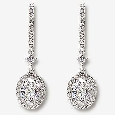 Elyse Oval Halo Cubic Zirconia Huggie Drop Earrings, 2.5 Ct TW...  Model: #5137V1, $795.00 ... Our Elyse drop earrings feature a micro pave huggie hoop top and a 1.0 carat each oval drop with cubic zirconia micro pave. Approximately 2.5 carats total weight, these earrings measure slightly under 1 1/4 inches (31.0mm) from top to bottom. Available in 14K white gold or 14K yellow gold.