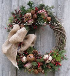 """Christmas Wreath, Holiday Wreath, Snowman, Jingle Bells, Woodland, Rustic, Primitive Christmas, Country Christmas Wreath Country Christmas Snowman Wreath. A sweet gathering of primitive snowmen, rusty jingle bells, holiday """"sentiment"""" pillows, rusty snowflakes, berries and pinecones nestled against pine boughs grace the edge of a rustic grapevine frame. A posh 4-loop burlap bow adds a warm and cozy touch to this charming holiday treasure. Realistic, high-quality silk floral and greenery..."""