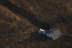 An aerial view shows a house pushed into marshland almost a month after the Oakwood neighborhood in the Staten Island borough of New York was left devastated by Hurricane Sandy, November 28, 2012. The storm killed 132, left thousands homeless and economic damages topping $50 billion. REUTERS/Adrees Latif (UNITED STATES - Tags: DISASTER ENVIRONMENT TPX IMAGES OF THE DAY)