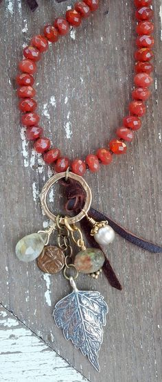 Sundance Style, Long faceted Carnelian Rondelles, Buttery Leather, Sterling Silver Vermeil Gold charms
