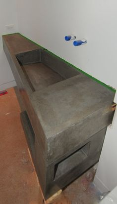 Ultra Modern Concrete Floating Bathroom Vanity - made locally in Kelowna BC  Vanity insanity, check out the level of customization on this hand cast concrete trough sink MODE CONCRETE created earlier this year.  It's a floating wall-mounted trough sink, and is no doubt a conversation starter.  We love working with clients to create one-of-a-kind custom designed pieces like this.