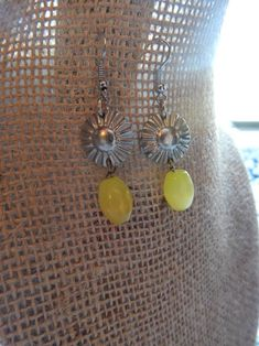 Excited to share the latest addition to my #etsy shop, one of my new favorite items!! Metal Sunflower button earring with small yellow drog bead. #jewelry #earrings #boho#JessieMayDesigns #sunflower #floral #dropdangle #etsyseller https://etsy.me/2GM3nEN