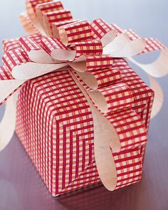 This wrap and bow were created using extra bits of paper; no ribbons or costly trimmings are necessary. The following instructions are for the box dimensions shown: 6-by-4 1/2-by-4 1/2-inch.