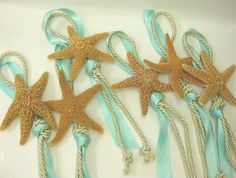 Large Starfish Aisle Marker with your choice of Ribbon Color. $15.00, via Etsy.