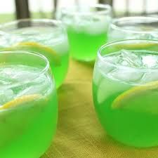 Trisha Yearwood's Green Punch Recipe  2 (.13-ounce) packets unsweetened Lemon-Lime Kool-Aid 2 cups sugar 1 (46-ounce) can pineapple juice 1 (12 ounce) can frozen lemonade concentrate, thawed 32 ounces (1 quart) ginger ale  Put 2 quarts of water in a 1-gallon container.  Add the drink mix and sugar, and stir until the sugar is dissolved.  Add the pineapple juice and lemonade concentrate; stir well.  Just before serving, add the ginger ale.