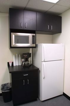 "Break Room. Designer is Ken Papa Dimensions = Base cabinets 32 1/2"" tall x 24"" deep, uppers 30 1/2"" tall x 13"" deep counter tops 25 1/2"" deep"