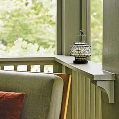 The top rail's ledge is deep enough to hold a drink glass, meaning this porch needs fewer tables. It is supported by chunky, curved brackets.