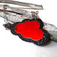 This sparkling little rain cloud is double sided with glitter black with metallic red on both sides.  I created the cloud using layers of glitter cardstock, metallic cardstock and reinforced the pendant with thin birch wood.  The edge of the cloud is lined with glossy black enamel.  The chain of this necklace is a gun metal grey and measures an adjustable 16 inches long.