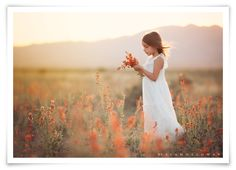 Lisa Holloway of LJHolloway Photography photographs her 2 little girls picking orange flowers at sunset in the desert near Las Vegas.