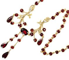 """Edwardian Necklace: ca. 1910, forty pyrope garnets set in round collets in 14k yellow gold, suspended from garnet is pair of gold batons with brace of round pyropes and a teardrop faceted garnet.  """"Pyrope garnets were not the sole province of Victorian era jewelry. Prized for their clarity, transparency and high light refractive index, these beauties vie for the attention that other precious gems typically garner."""""""