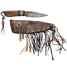 Handcrafted belt knife, featuring an elk antler handle, forged 5160 carbon steel blade with forge texture, patterned brass band and blacksmith's curl. Decorated, rawhide sheath with copper tacking.