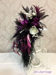 Bridal teardrop bouquet made with feathers and roses for a purple black and white themed wedding