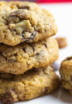 Delicious Neiman Marcus Cookie Recipe stacked up with nuts sprinkled around the cookies 250 Cookie Recipe, Neiman Marcus Cookie Recipe, Cookie Desserts, Cookie Recipes, Baking Desserts, Cookie Ideas, Neman Marcus Cookies, Hermit Cookies, Pecan Sandie Recipe
