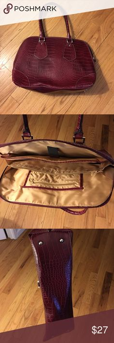 Women's Briefcase 💼 Looks like a purse but it's a stylish brief case. Has a slot for pens, paper, iPad or laptop, as well as for your personal belongings so you don't need to carry a purse. Used once for an interview and never had a chance to use it again. A little bent/dented from being in the closet, but can be adjusted with use. It is not damaged. Bags Laptop Bags