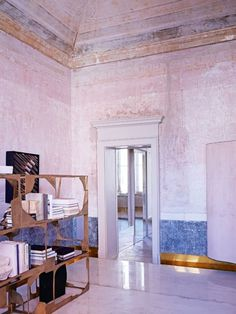 House tour: a Milanese palazzo beautifully stripped back to its roots Italian architect and sculptor Vincenzo de Cotiis's 18th-century palazzo apartment in the heart of Milan. By Becky Sunshine. Photographed by Kasia Gatkowska. 17th Jul 2016 INTERIORS In the study/library, cast brass 'DC1514' bookcase by de Cotiis on resin-topped platform