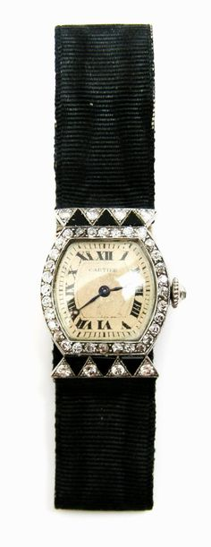 Diamond and onyx dress watch by Cartier, Paris, c. 1925 , signed to the dial and numbered to the reverse 7028
