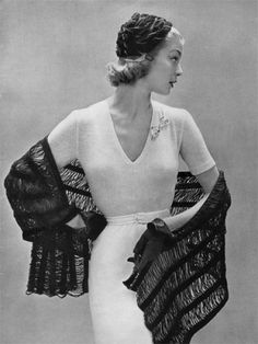 Jean Patchett modelling 1950s fashions:    this shawl would be fairly easy to make, with a knitted drop stitch.