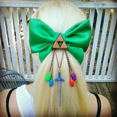 Legend of Zelda hair bow! It seems as if it is made by baked clay;polymers clay with chains obviously but I'm sure that I need this is my life I shall use my emergency money lol jk but still