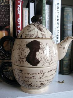 Jane Austen, Tea for One, Tea set I made for my aunt. This is actually a re-do, on my first one the paint flaked off. The top is a lace technique, the middle is a stamp and Jane Austen's silhouette, and the bottom teacup has the opening lines from Pride and Prejudice. by: RubyMarilyn on Flickr