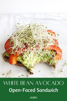 A delicious open-face sandwich made with smashed white beans, creamy avocado, bell peppers, and sprouts on toasted bread.