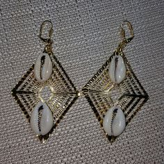 Gold tone cowrie shells earrings Gold tone cowrie shells earrings with gold lever backs ear wires hypoallergenic! Jewelry Earrings