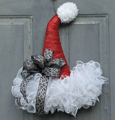 DIY Christmas wreath for your front door. How to make a Santa hat Christmas wreath DIY for your DIY Christmas decorations this holiday season. A Hometalk DIY holiday design on dime decorating project for winter. You might want to buy some Mesh Garland, Deco Mesh Wreaths, Yarn Wreaths, Ribbon Wreaths, Floral Wreaths, Burlap Wreaths, Door Wreaths, Christmas Ornament Wreath, Christmas Crafts